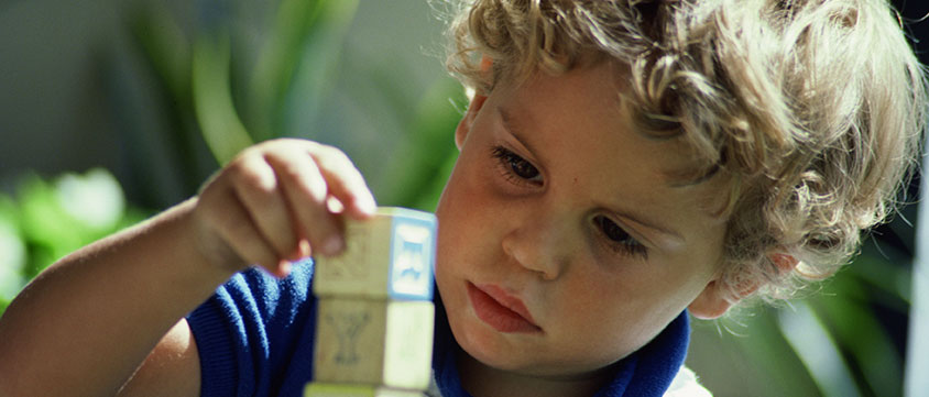 boy-with-blocks-childsplay-consultancy